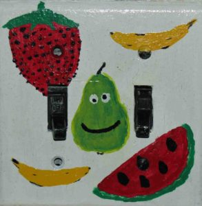 Photograph of light-switch cover painted with fruit.