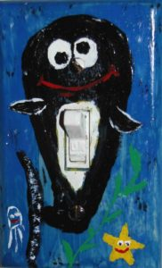 Photograph of light-switch cover painted with whale.