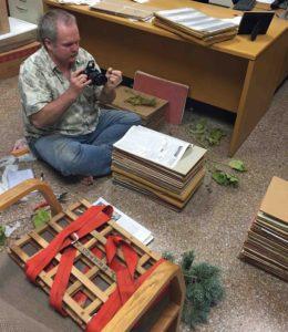 Photograph of Richard pressing plants