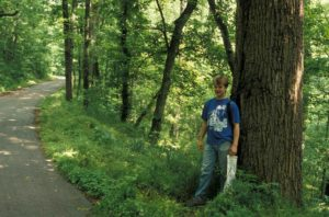Photograph of Richard at edge of woods