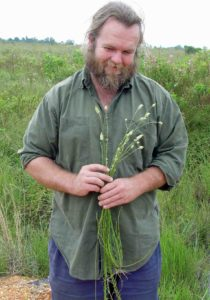 Photograph of Richard collecting plants in Belize