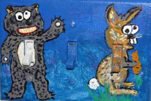 Photograph of light-switch cover painted with a bunny and a bear