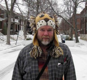 Photograph of Richard Abbott with lion hat